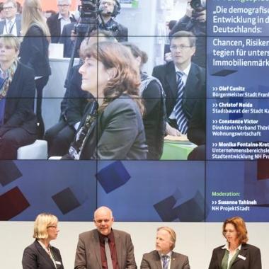 """Expertengespräch mit der NH ProjektStadt auf der Expo Real 2015: """"Die demografische Entwicklung in der Mitte Deutschlands: Chancen, Risiken und Strategien für unterschiedliche Immobilienmärkte"""""""