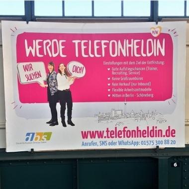 Werbung der DBS GmbH am U-Bahnhof Gleisdreieck: Werde Telefonheld/in!