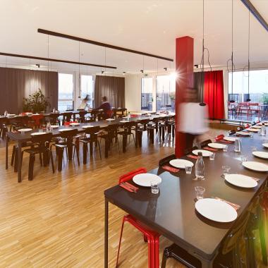 In unserer Cafeteria treffen sich die Mitarbeiter gerne zum gemeinsamen Mittagessen. Die angrenzende Dachterrasse ist vor allem im Sommer sehr beliebt.